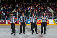 KELOWNA, CANADA - APRIL 30: Referee Reagan Vetter, linesman, Nathan Vanoosten, referee Steve Papp and linesman Nick Bilko stand on the ice at the Kelowna Rockets on April 30, 2017 at Prospera Place in Kelowna, British Columbia, Canada.  (Photo by Marissa Baecker/Shoot the Breeze)  *** Local Caption ***