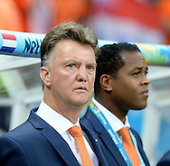 Louis van Gaal (left) head coach  of Netherlands with his assistant Patrick Kluivert during the 2014 FIFA World Cup match at the Itaipava Arena Fonte Nova, Nazare, Bahia<br /> Picture by Stefano Gnech/Focus Images Ltd +39 333 1641678<br /> 05/07/2014