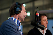 Jan van Doggenaar van SHO (links) en Marco Borsato zijn te gast in het radioprogramma van Sander de Heer om uitleg te geven over de actie voor Pakistan. In het Nederlands Instituut voor Beeld en Geluid in Hilversum verzamelt een telefoonteam de donaties voor de actie van de Samenwerkende Hulporganisaties (SHO) voor de watersnoodramp in Pakistan. Via een televisieactie worden Nederlanders opgeroepen om geld te geven via Giro 555.<br /> <br /> At the museum for media in Hilversum a call center is taking calls for a donation to the victims of the flooding in Pakistan. The cooperation of aid reliefs is asking people in The Netherlands to donate. Famous Dutchmen are supporting the fund raising. Amongst them is Dutch singer Marco Borsato (right), who opened the fund raising.