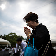 NAGASAKI, JAPAN - AUGUST 9 : Visitors pray for the atomic bomb victims in front of the Nagasaki Peace Park in Nagasaki, southern Japan, Tuesday, August 9, 2016. Japan marked the 71st anniversary of the atomic bombing on Nagasaki. On August 9, 1945, during World War II, the United States dropped the second Atomic bomb on Nagasaki city, killing an estimated 40,000 people which ended World War II. (Photo by Richard Atrero de Guzman/NURPhoto)