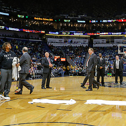 Feb 7, 2018; New Orleans, LA, USA; New Orleans Pelicans forward Anthony Davis (right) looks on as worker clean the court during a delay the game between the New Orleans Pelicans and the Indiana Pacers was postponed after a nearly two hour delay due to a roof leak at the Smoothie King Center. Mandatory Credit: Derick E. Hingle-USA TODAY Sports