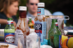 Beers and sauces on a garden party table,