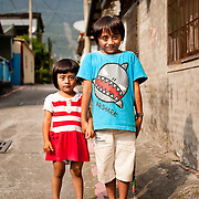 A Rukai brother and sister pose for a photo, Maolin Township, Kaohsiung County, Taiwan