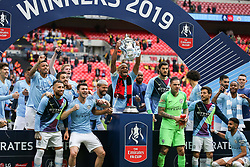 Vincent Kompany of Manchester City leads the celebrations with the trophy - Mandatory by-line: Arron Gent/JMP - 18/05/2019 - FOOTBALL - Wembley Stadium - London, England - Manchester City v Watford - Emirates FA Cup Final
