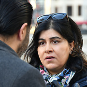 "Speaker Baroness Warsi at Penny Appeal Team Orange unveiling 5 life-size ice statues ""What Would Jesus Do?"", symbolising homeless families to promote their winter campaign. The frozen family will depict the plight of the 140* families who become homeless everyday, and the 900* children who become homeless every month on 17th December at Canary Wharf, London, UK."