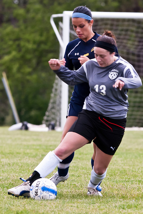 Lathan Goumas | MLive.com..May 9, 2012 - Megan Harp of Linden High School steals the ball during a girls soccer game against Lapeer West High School at Linden High School in Argentine Township, Mich. on dow. Lapeer defeated Linden 1-0.