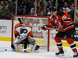 Mar 30, 2007; East Rutherford, NJ, USA; New Jersey Devils right wing Jamie Langenbrunner (15) looks for a rebound as Philadelphia Flyers goalie Martin Biron (43) makes a save during the second period at Continental Airlines Arena in East Rutherford, NJ.