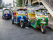 "05 APRIL 2014 - BANGKOK, THAILAND:   Tuk-tuks in Khlong Toey Market in Bangkok. Khlong Toey (also called Khlong Toei) Market is one of the largest ""wet markets"" in Thailand. The market is located in the midst of one of Bangkok's largest slum areas and close to the city's original deep water port. Thousands of people live in the neighboring slum area. Thousands more shop in the sprawling market for fresh fruits and vegetables as well meat, fish and poultry.     PHOTO BY JACK KURTZ"