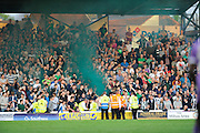 A green smoke bomb is let off after Plymouth Argyle equalise during the Sky Bet League 2 play-off first leg match between Portsmouth and Plymouth Argyle at Fratton Park, Portsmouth, England on 12 May 2016. Photo by Graham Hunt.