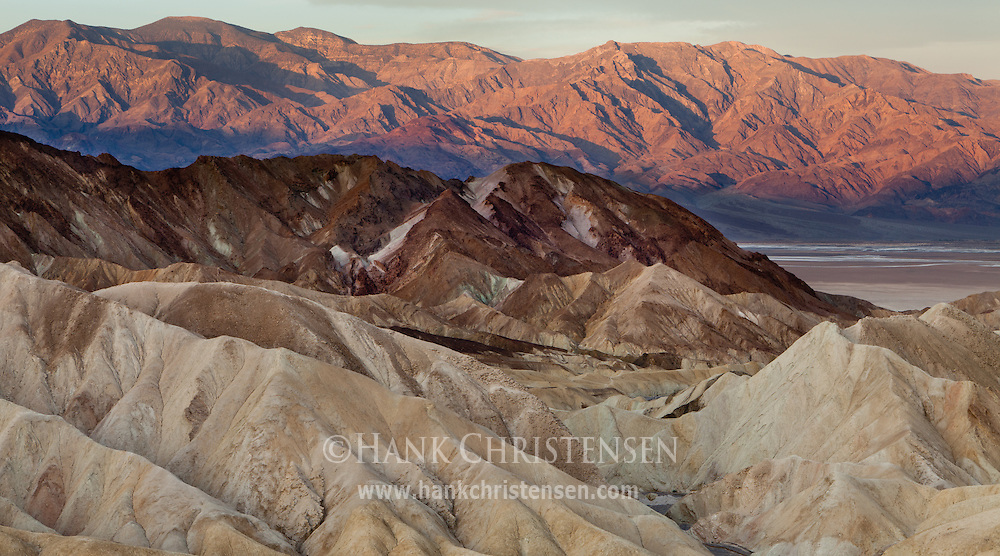 Sunlight creeps down the distant mountains as another day arrives at Death Valley National Park