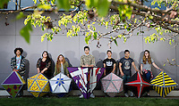 From left, Isaiah Bourland, Erika Gordova, Abbie Meraz, Luis Martinez, Walter Gonzalez Fuentes, Marco Garcia and Zoe Karner pose with their polyhedron art work at Grand Island Public Library. (Independent/Matt Dixon)