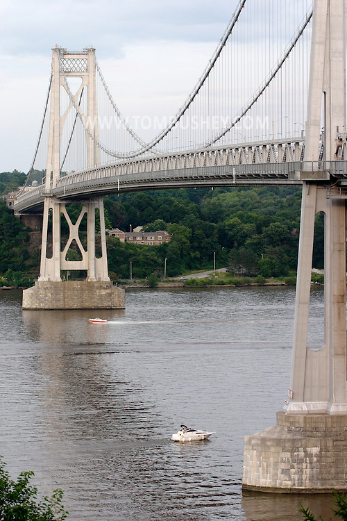 Highland, N.Y. - Boats onn the Hudson River  pass underneath the Mid-Hudson Bridge between Highland and Poughkeepsie on July 8, 2006. ©Tom Bushey