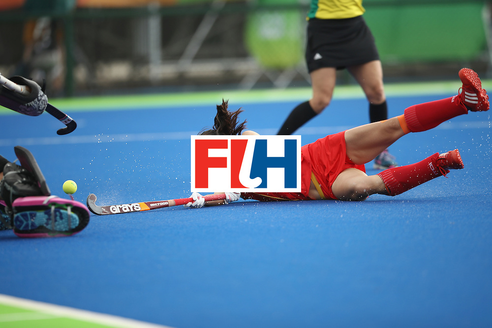 RIO DE JANEIRO, BRAZIL - AUGUST 07:  Hongxia Li of China falls after diving to shot at goal during the women's pool A match between China and Germany on Day 2 of the Rio 2016 Olympic Games at the Olympic Hockey Centre on August 7, 2016 in Rio de Janeiro, Brazil.  (Photo by Mark Kolbe/Getty Images)