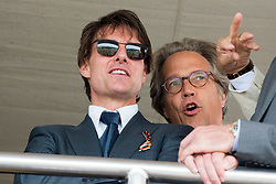 © Licensed to London News Pictures. 31/07/2014. Chichester, UK Hollywood actor Tom Cruise chats to Lord March, the owner of the Goodwood Estate.  Ladies Day at Glorious Goodwood at Goodwood racecourse in Chichester today 31/07/14. Photo credit : Stephen Simpson/LNP