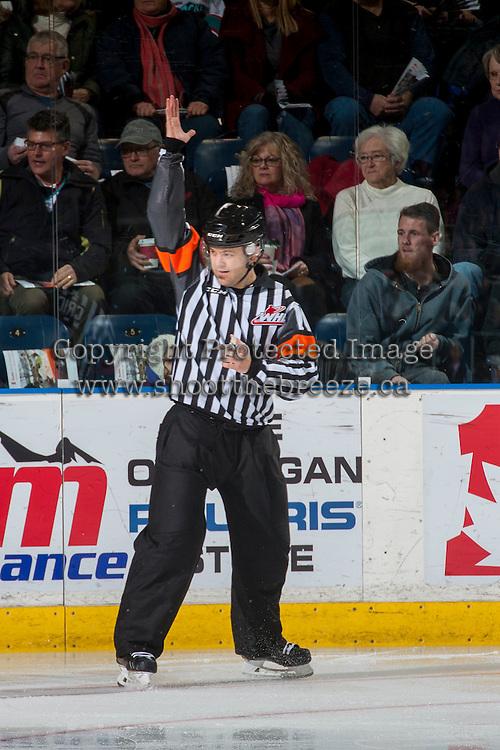KELOWNA, CANADA - JANUARY 7: Referee Chris Crich makes a call at the Kelowna Rockets against the Kamloops Blazers on January 7, 2017 at Prospera Place in Kelowna, British Columbia, Canada.  (Photo by Marissa Baecker/Shoot the Breeze)  *** Local Caption ***