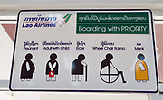 Laos, Champasak Province. Pakse airport. Priority seating for Buddhist monks!