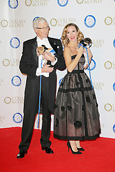 © Licensed to London News Pictures. 07/11/2013.  Paul O'ôGrady and Amanda Holden attending the Battersea Dogs & Cats Home Collars & Coats Gala Ball at Battersea Evolution, London UK. Photo credit: by Richard Goldschmidt/LNP