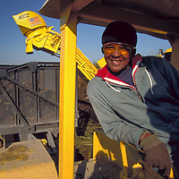 Tractor driver at  Wedgworth Farms.  For the Sugar Cane Growers Cooperative of Florida annual report.