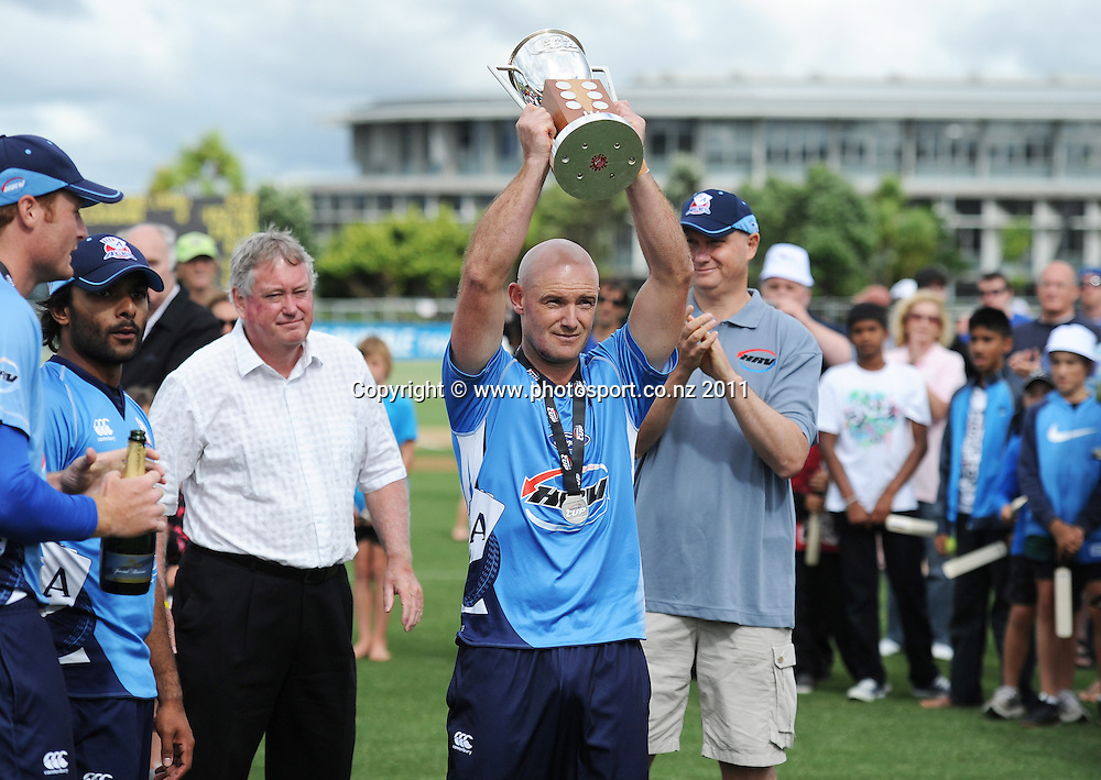 Gareth Hopkins with the HRV Cup after winning the HRV Twenty20 Cricket Final between the Auckland Aces and Canterbury Wizards at Colin Maiden Oval in Auckland, New Zealand on Sunday 22 January 2012. Photo: Andrew Cornaga/Photosport.co.nz