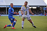 Peterborough midfielder Joe Ward and Burton Albion defender Jake Buxton (3) during the EFL Sky Bet League 1 match between Peterborough United and Burton Albion at London Road, Peterborough, England on 4 May 2019.