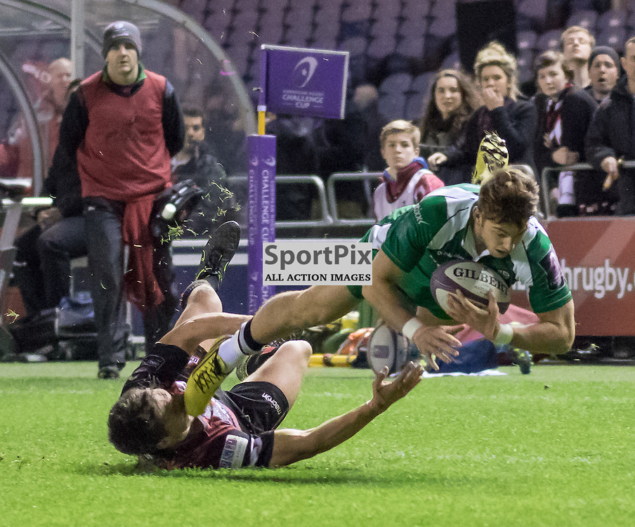 London Irish #14 Alex Lewington is tackled on his way past the Edinburgh defence.  Edinburgh Rugby v London Irish, 18th December 2015