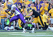 September 15 2012: Northern Iowa Panthers running back David Johnson (7) pulls in a pass as he is hit by Iowa Hawkeyes defensive back Tanner Miller (5) and linebacker James Morris (44) during the second half of the NCAA football game between the Northern Iowa Panthers and the Iowa Hawkeyes at Kinnick Stadium in Iowa City, Iowa on Saturday September 15, 2012. Iowa defeated Northern Iowa 27-16.