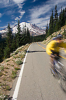 Young man cycling in Mount Rainier National Park, WA.