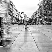 FRANCE. Paris, Ile-de-France. November 13th, 2013. A skateboarder prepares for his next trick in the early afternoon, at the Place de la Republique, a square that lies on the border between the 3rd, 10th and 11th arrondissements.