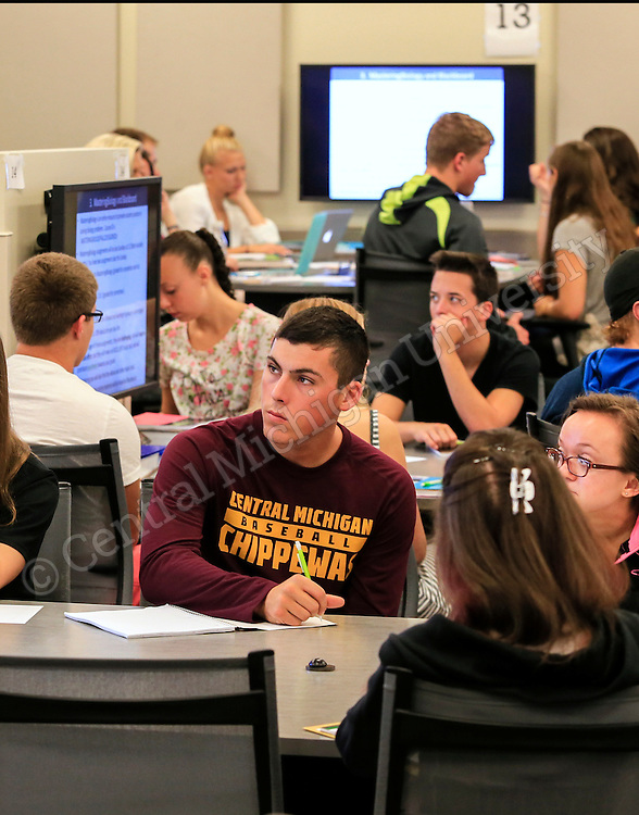 Dr. Steven Gorich teaches Welcome to BIO 110: Concepts of Biology in an applied learning classroom in Dow Hall as fall semester classes begin at Central Michigan University on Monday August 31, 2015. Students do much of their work in small groups. Photos by Steve Jessmore/Central Michigan University