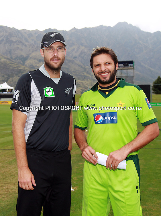 Captain's Daniel Vettori and Shahid Afridi pose for a picture against the backdrop of the Remarkables Mountain range at the Queenstown Events Centre. 2nd ODI, Black Caps v Pakistan, One Day International Cricket. Queenstown, New Zealand. Wednesday 26  January 2011. Photo: Andrew Cornaga/photosport.co.nz