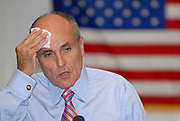 Former New York City Mayor and 2008 Republican Presidential Candidate Rudy Giuliani wipes sweet from his forhead while taking questions during a ?Town Hall? style meeting at Oglethorpe University in Atlanta, Georgia.