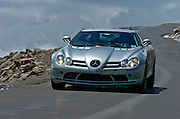 A Mercedes Benz test car comes down from the summit of Mt Evans in Colorado.