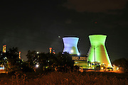 Israel, Haifa bay, The oil refinery, night shot of the vividly illuminated flues .