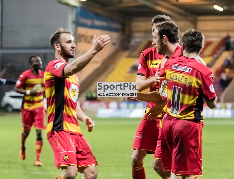 Thistle player rush to celebrate with Stuart Bannigan after his shot at goal during the Partick Thistle FC V Ross County FC Ladbrokes Scottish Premiership game played at Firhill Stadium, Glasgow on 19th December 2015; (c) BERNIE CLARK | SportPix.org.uk