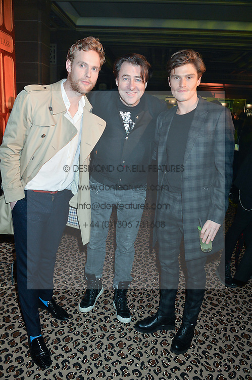 Left to right, JACK FOX, JONATHAN ROSS and OLIVER CHESHIRE at the Warner Music Brit Party held at the Freemason's Hall, 60 Great Queen Street, London on 25th February 2015.