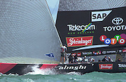 Alinhi and Team New Zealand do a time and distance run to the start line for race 5 of the 2003 America's Cup. 2/3/2003 (© Chris Cameron 2003)