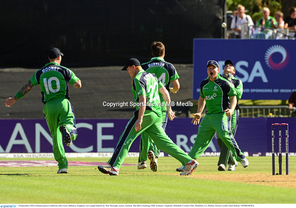 3 September 2013; Ireland players celebrate after Gary Ballance, England, was caught behind by Tim Murtagh, center, Ireland. The RSA Challenge ODI, Ireland v England, Malahide Cricket Club, Malahide, Co. Dublin. Picture credit: Paul Mohan / SPORTSFILE