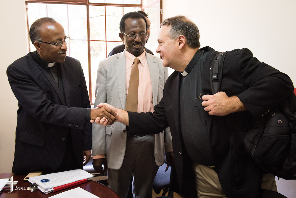 The Rev. Dr. Lawrence R. Rast, Jr., chairman of the Commission on Theology and Church Relations (CTCR) and president of Concordia Theological Seminary in Fort Wayne, Ind., greets the Rev. Yonas Yigezu, director of Mission and Theology (DMT) for the Ethiopian Evangelical Church Mekane Yesus, during introductions at the Mekane Yesus Seminary Monday, Nov. 10, 2014 in Addis Ababa, Ethiopia. LCMS Communications/Erik M. Lunsford