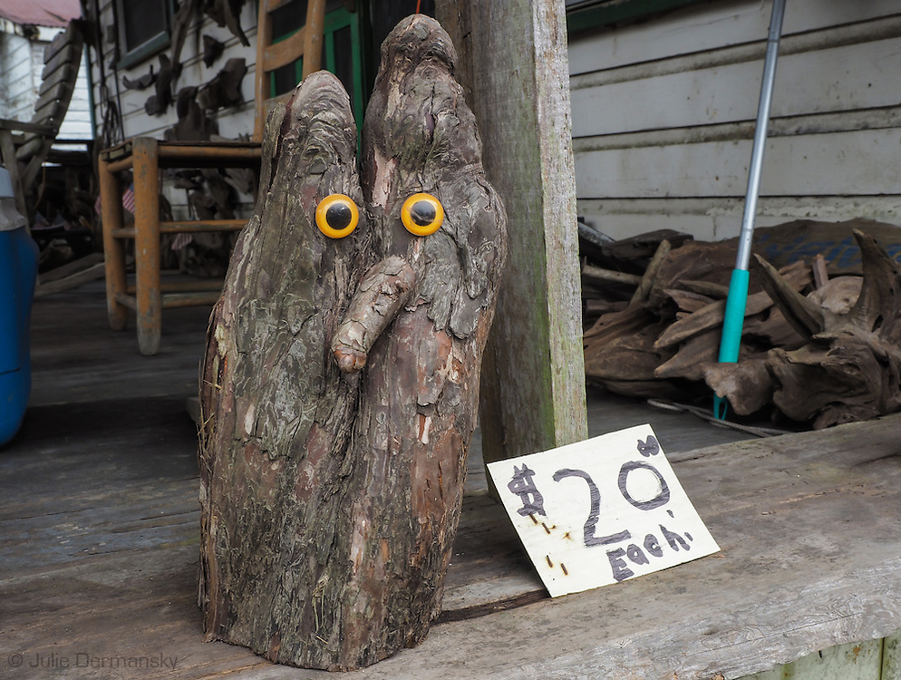 An owl sculpture by self-taught artist, Adama Morales  at Adam's Cypress Swamp Driftwood Family Museum in Pierre Part, Louisiana.