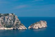 The rocky cliffs in the Cala La Granadella and El descubridor island, Javea, Costa Blanca, Alicante province, Spain