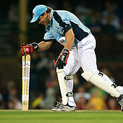 Phil Waugh effects a run out during the Australia's Big Bash Cricket match to raise money for the Victorian Bushfire Appeal at the Sydney Cricket Ground, Sydney, Australia on February 22, 2009. The match was attended by over 20,000 spectators. Photo Tim Clayton