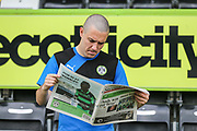 Forest Green Rovers Liam Noble(15) reads the sport stories in the local paper during the Forest Green Rovers Press Conference and Training session at the New Lawn, Forest Green, United Kingdom on 12 May 2017. Photo by Shane Healey.