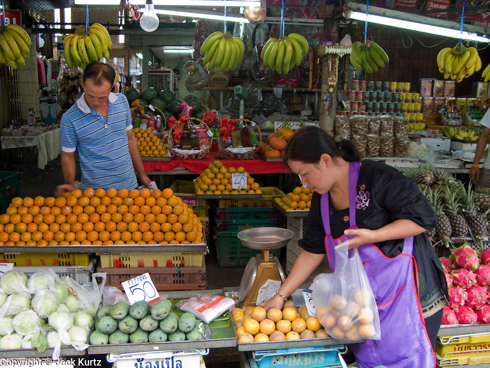 20 FEBRUARY 2008 -- KANCHANABURI, THAILAND: Fruit vendors in the market in Kanchanaburi, Thailand.  Photo by Jack Kurtz