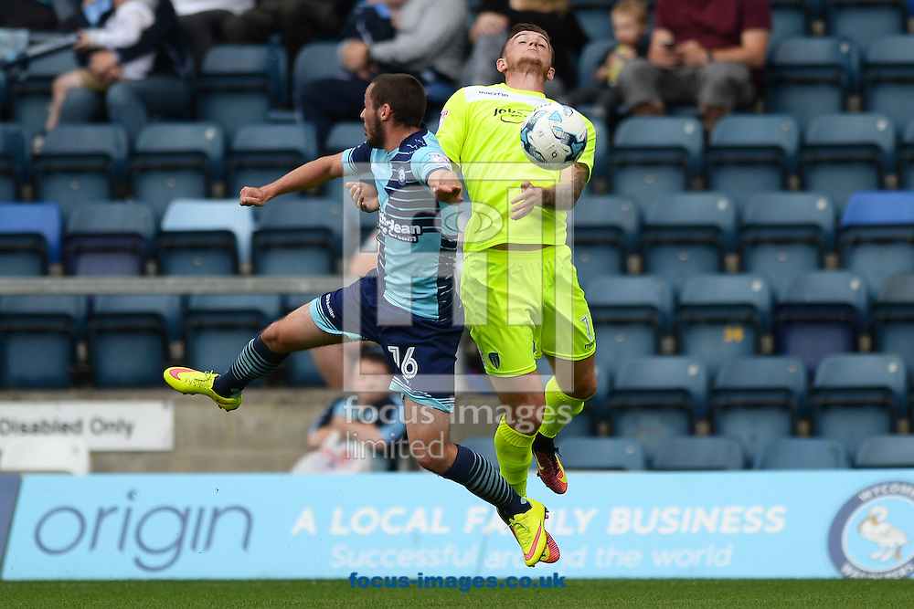 Ben Dickenson of Colchester United looks to win a header in the air against Michael Harriman of Wycombe Wanderers during the Sky Bet League 2 match between Wycombe Wanderers and Colchester United at Adams Park, High Wycombe<br /> Picture by Richard Blaxall/Focus Images Ltd +44 7853 364624<br /> 27/08/2016