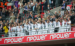 LONDON, ENGLAND - Saturday, May 30, 2011: Swansea City's Ferrie Bodde lifts the trophy after beating Reading 4-2 during the Football League Championship Play-Off Final match at Wembley Stadium. (Photo by David Rawcliffe/Propaganda)