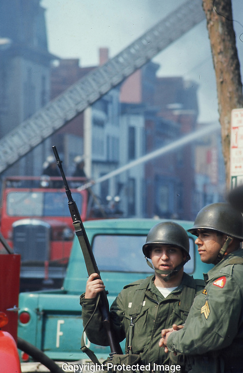 National guard soldiers talk on 14th Street during the riots in Washington, DC in April 1968..Photograph by Dennis Brack BBBs 20