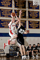 Moultonaboro's Drew Swedburg goes up for the shot guarded by Prospect Mountain's Jay Mousseau during Holiday Tournament action at Gilford High School Tuesday evening.  (Karen Bobotas/for the Laconia Daily Sun)