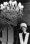 Parlourmaid under chandelier, 1940s