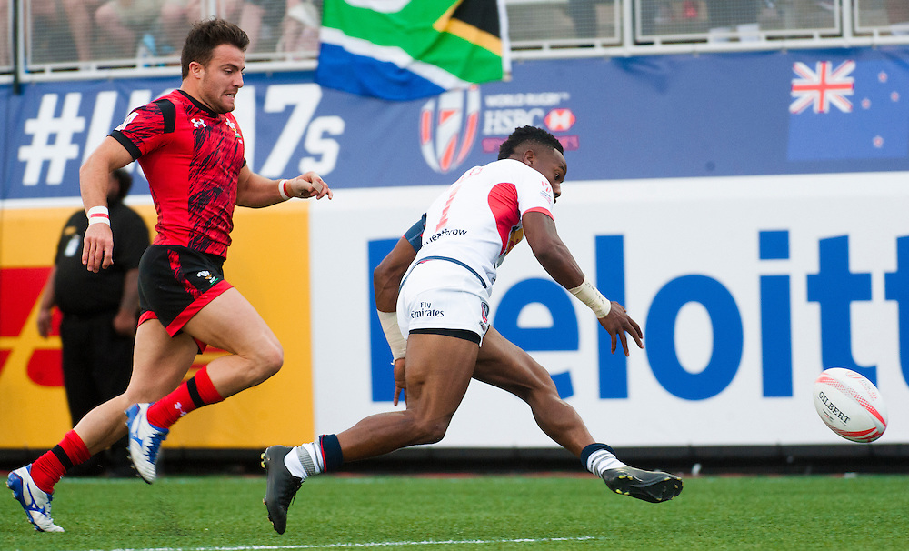 Carlin Isles of the United States wins a foot race to score a try against Wales during the pool stage of the 2016 USA Sevens leg of the HSBC Sevens World Series at Sam Boyd Stadium  Las Vegas, Nevada. March 4, 2016.<br /> <br /> Jack Megaw for USA Sevens.<br /> <br /> www.jackmegaw.com<br /> <br /> 610.764.3094<br /> jack@jackmegaw.com
