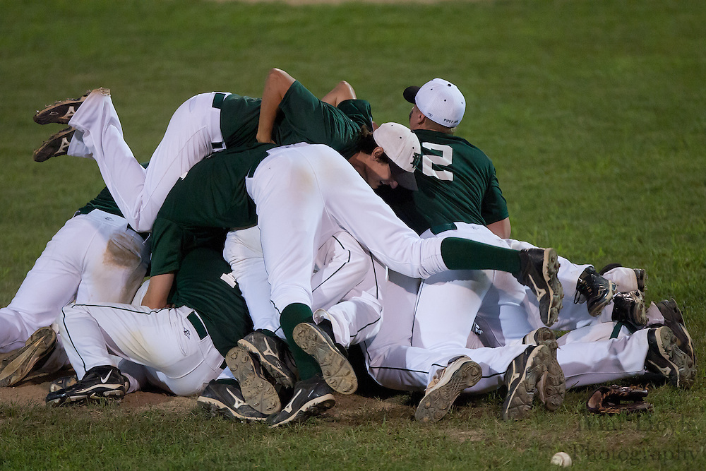 The West Deptford all-stars pile up in the infield after winning the district 15 tournament finals Saturday.